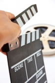 Hand Holding Clapperboard by Ponsulak on Freedigitalphotos.net