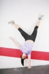Flexible girl standing on one hand